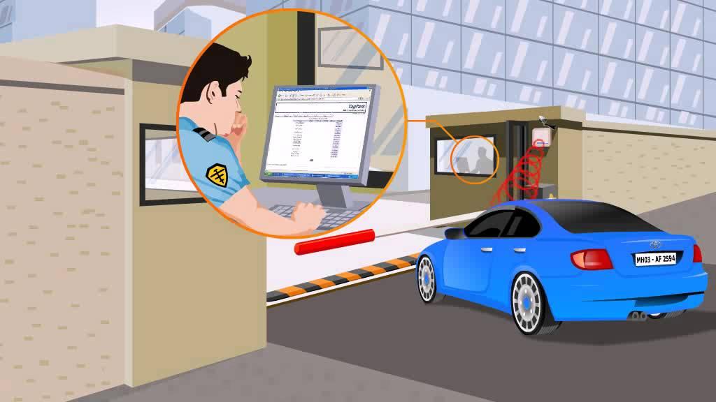 Nhân viên gác chắn ngồi trong buồng máy để kiểm soát xe ra vào